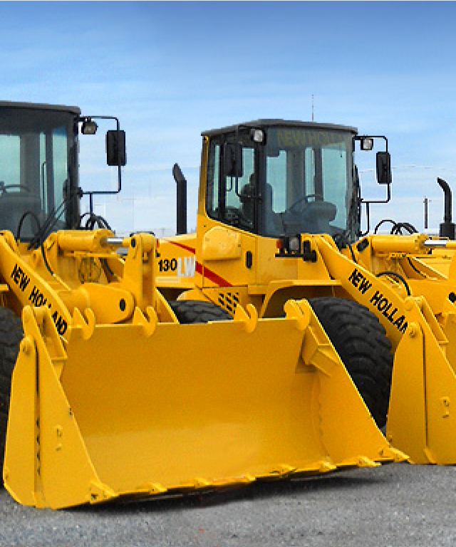 Two construction loaders next to each other on asphalt. - TAB Bank